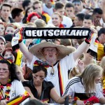 A fan of the German team holds a scarf r